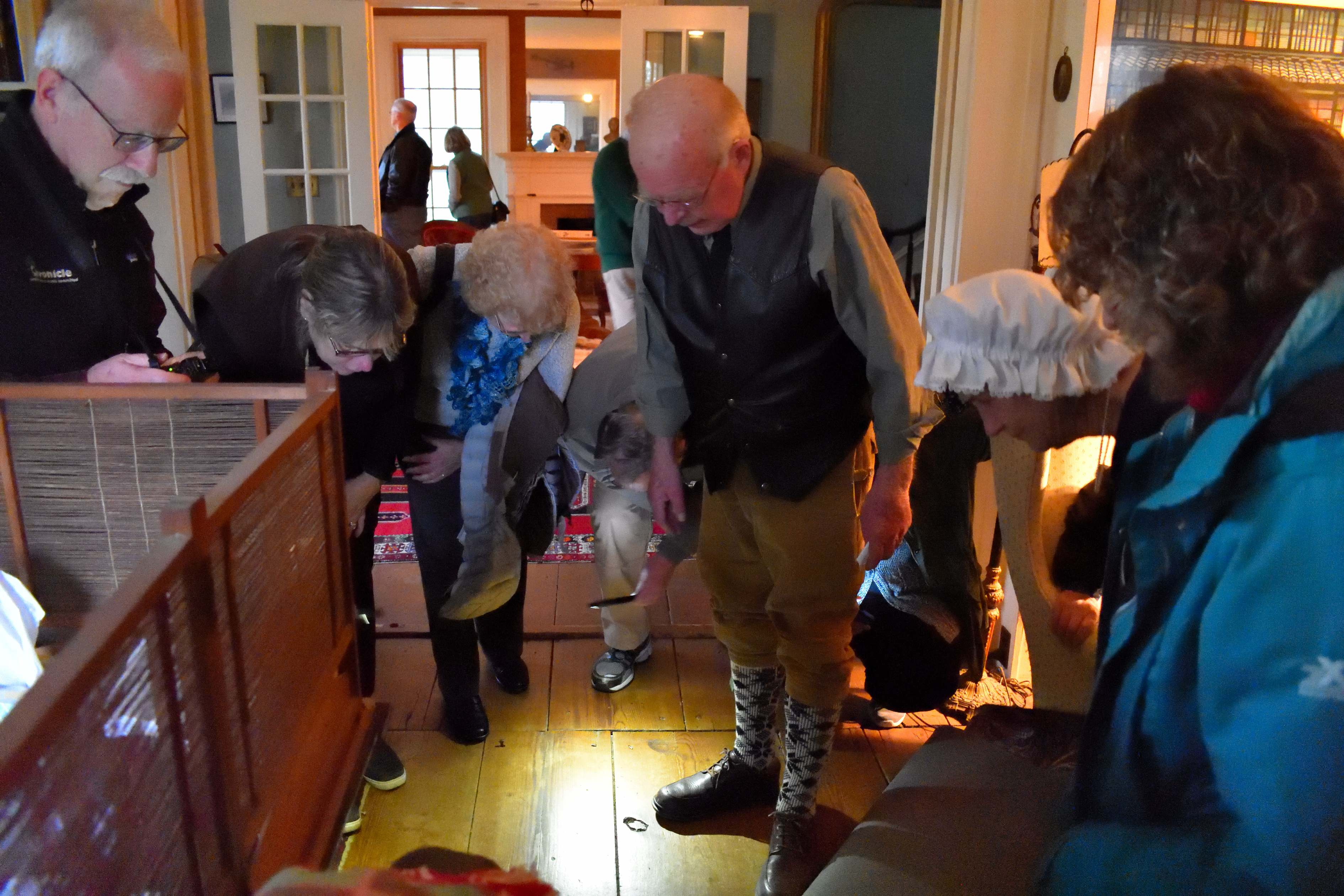 Owner David Bullard showing visitors the blood stains left by wounded soldiers when The Marshall House was used as a hospital during the retreat of the British forces following their defeat at the Battles of Saratoga.